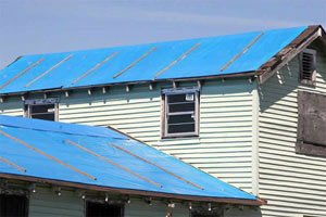Blue roofing tarp for waterproofing