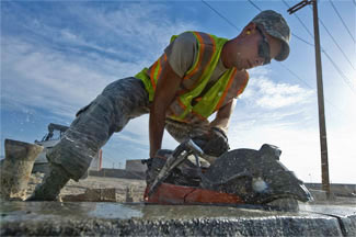 Soldier Cutting Wet Concrete