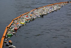 Orange Boom Erosion Control Product holding back floating trash